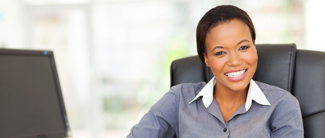African American Lady Smiling in Office